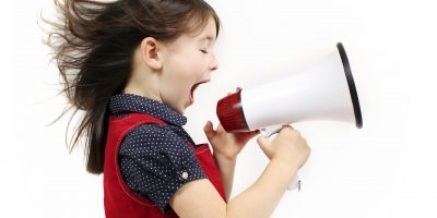 Young girl shouting over a megaphone